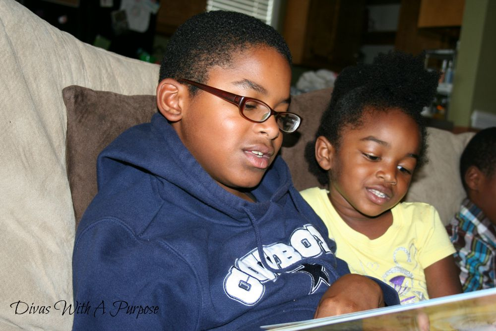 Invest In Childhood | Siblings Reading