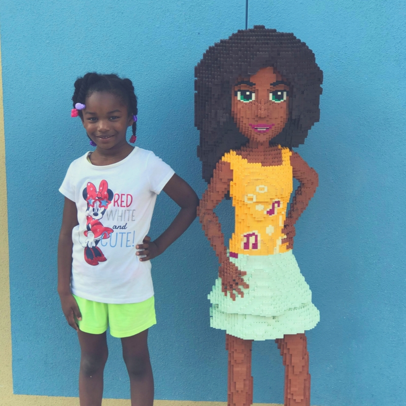 Posing with the figurines at LEGOLAND Florida