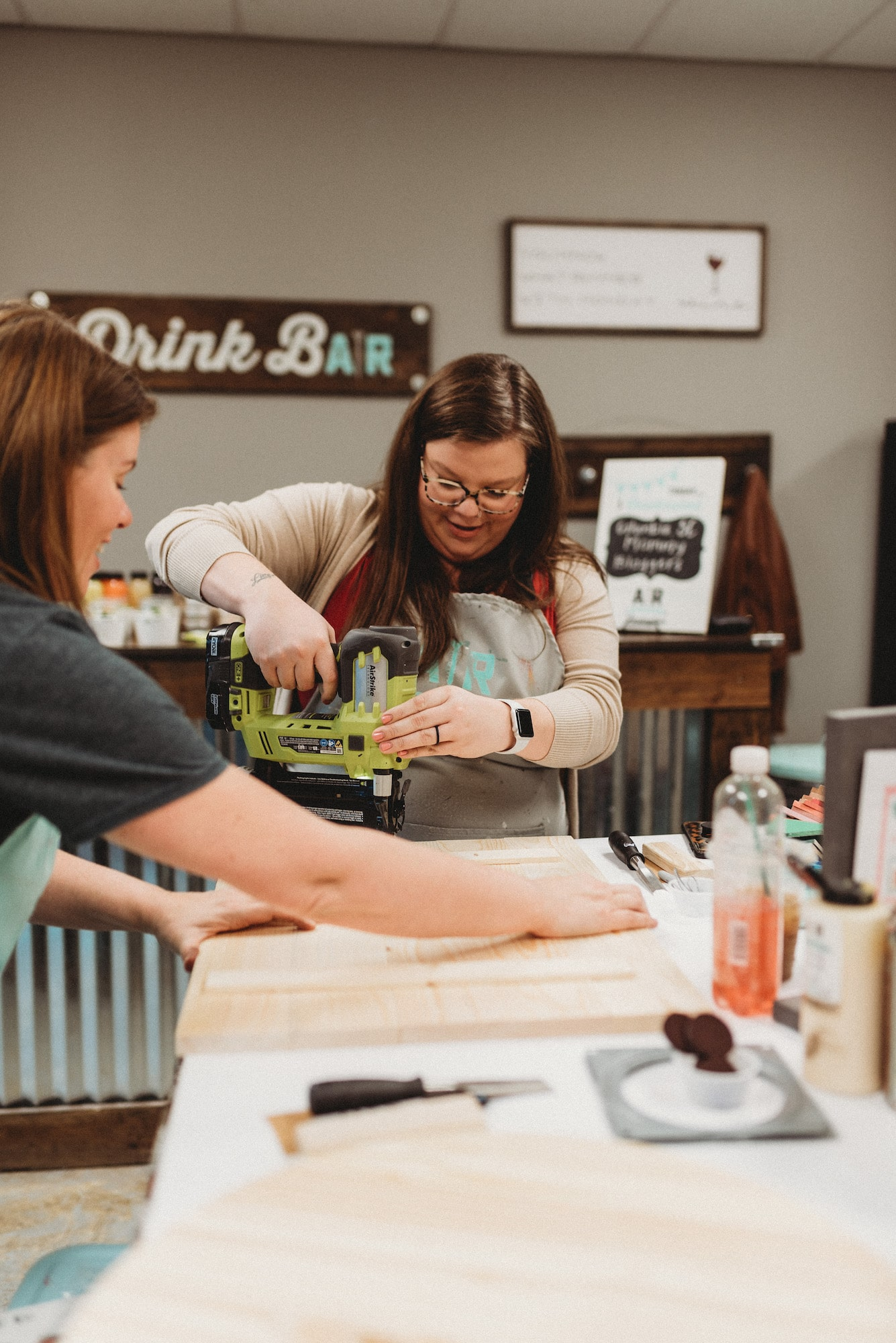 while it's tempting to get all dressed up for a girls' night out, keep in mind you're going to handle wood, paint, and possibly power tools. It's okay to dress down. You'll be wearing an oh-so-stylish AR Workshop-provided smock